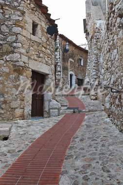 Narrow street in the ancient medieval city of Eze Village in the South of France along the Mediterranean Sea Stock Photo - Royalty-Free, Artist: porojnicu                     , Code: 400-05719850