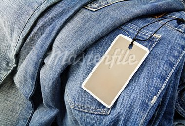 Jeans trousers with blank paper label Stock Photo - Royalty-Free, Artist: donatas1205                   , Code: 400-05720000