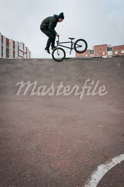 Biker doing footjam tailwhip trick with houses on background Stock Photo - Royalty-Free, Artist: dmitryelagin                  , Code: 400-05721354