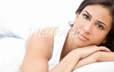 Studio portrait of a beautiful young Latina Hispanic young woman or girl looking thoughtful resting on her hands Stock Photo - Royalty-Free, Artist: darrenbaker                   , Code: 400-05721398
