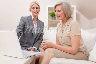 A young saleswoman showing a senior woman medical insurance or pension information on a laptop computer Stock Photo - Royalty-Free, Artist: darrenbaker                   , Code: 400-05721404