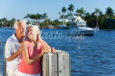 Happy senior man and woman couple together by a river or sea in a tropical location with a boat sailing past Stock Photo - Royalty-Free, Artist: darrenbaker                   , Code: 400-05721408