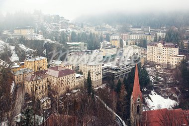 Aerial view down on Bad Gastein (Austria, Alps) town, mineral waters and ski resort and mountains in fog Stock Photo - Royalty-Free, Artist: Dinga                         , Code: 400-05721684