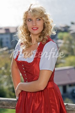 young blond woman in red Bavarian dress Stock Photo - Royalty-Free, Artist: STphotography                 , Code: 400-05721910