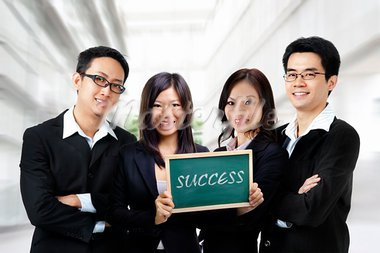 Asian business team on office background, blackboard on hand. Stock Photo - Royalty-Free, Artist: szefei                        , Code: 400-05722896