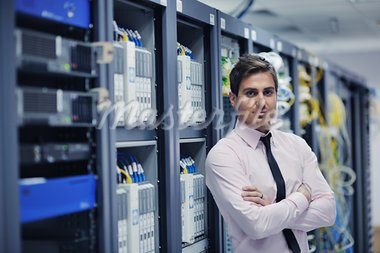 young handsome business man  engeneer in datacenter server room Stock Photo - Royalty-Free, Artist: dotshock                      , Code: 400-05728734