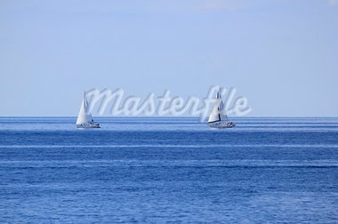 Two sailboats on open blue sea horizon Stock Photo - Royalty-Free, Artist: xbrchx                        , Code: 400-05728773