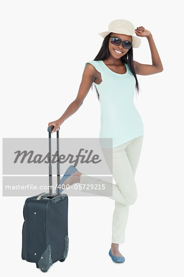 Happy smiling woman with her suitcase against a white background Stock Photo - Royalty-Free, Artist: 4774344sean                   , Code: 400-05729215