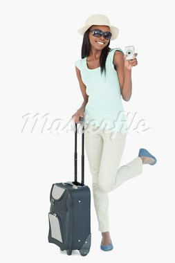 Smiling young woman traveling against a white background Stock Photo - Royalty-Free, Artist: 4774344sean                   , Code: 400-05729219