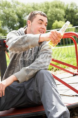 Young Man Sitting In Playground Drinking Beer Stock Photo - Royalty-Free, Artist: MonkeyBusinessImages          , Code: 400-05729540