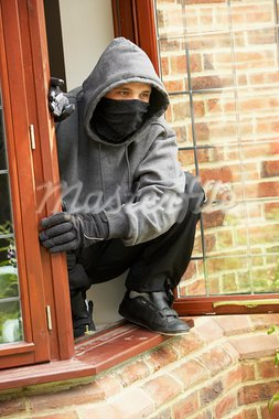 Young Man Breaking Into House Stock Photo - Royalty-Free, Artist: MonkeyBusinessImages          , Code: 400-05729543
