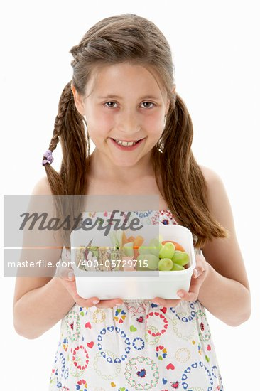Studio Portrait of Smiling Girl Holding Lunchbox Stock Photo - Royalty-Free, Artist: MonkeyBusinessImages          , Code: 400-05729715