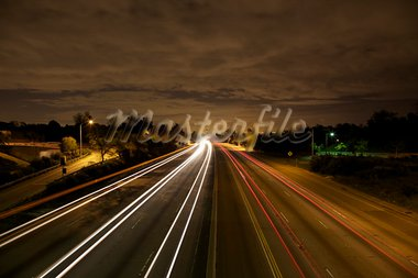 Very clean D-SLR long exposure. No noise. West Los Angeles skyline at night with traffic streaking by on the 405 freeway.   Stock Photo - Royalty-Free, Artist: eyeidea                       , Code: 400-05730364