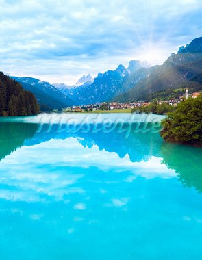 Tranquil summer Italian dolomites mountain lake and village view (Auronzo di Cadore) Stock Photo - Royalty-Free, Artist: Yuriy                         , Code: 400-05730608