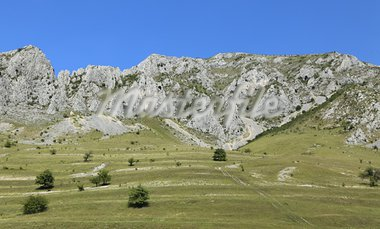 Summer image with rocks,grass and blue sky in Trascau Mountains,Transylvania,Romania.   Stock Photo - Royalty-Free, Artist: RazvanPhotography             , Code: 400-05730896
