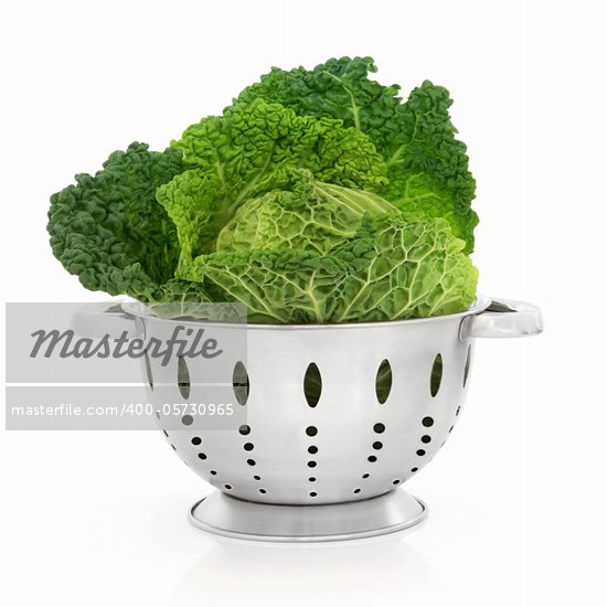 Savoy cabbage in a stainless steel colander isolated over white background. Stock Photo - Royalty-Free, Artist: marilyna                      , Code: 400-05730965