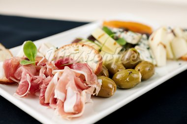 Snacks selection for wines (Parma ham, olives, cheese) Stock Photo - Royalty-Free, Artist: mtoome                        , Code: 400-05731319