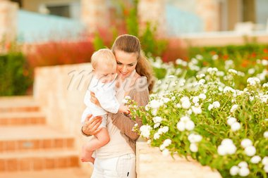 Caring mother showing plants to her interested baby   Stock Photo - Royalty-Free, Artist: citalliance                   , Code: 400-05731563