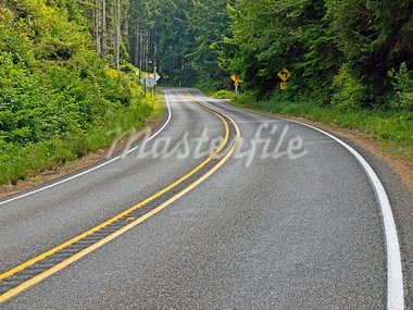 Curved Two Lane Country Road Winding Through a Forest Stock Photo - Royalty-Free, Artist: Frank_L_Jr                    , Code: 400-05732023