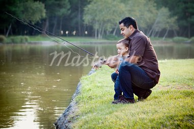 Happy Young Ethnic Father and Son Fishing at the Lake. Stock Photo - Royalty-Free, Artist: Feverpitched                  , Code: 400-05732083