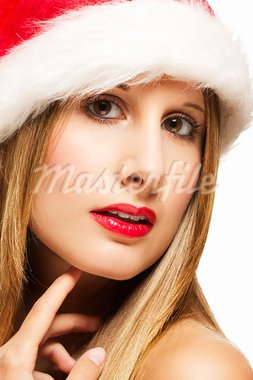 christmas closeup of a glamorous woman wearing santas hat on white background Stock Photo - Royalty-Free, Artist: RobStark                      , Code: 400-05732401