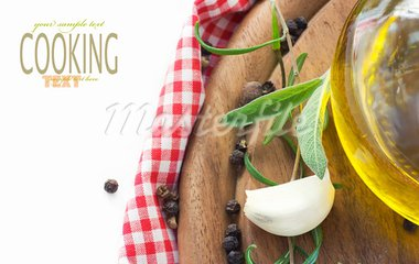 Cooking ingredients with copyspace. Garlic with olive oil , pepper and rosemary Stock Photo - Royalty-Free, Artist: mythja                        , Code: 400-05732415