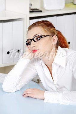 Beautiful caucasian woman in glasses thinking and sitting in the office. Stock Photo - Royalty-Free, Artist: BDS                           , Code: 400-05732669