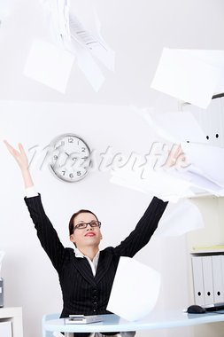 Pretty caucasian businesswoman throwing sheets of paper. Stock Photo - Royalty-Free, Artist: BDS                           , Code: 400-05732713