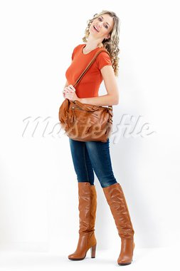 woman wearing fashionable brown boots with a handbag Stock Photo - Royalty-Free, Artist: phbcz                         , Code: 400-05732739