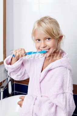 Girl brushing teeth in the bathroom Stock Photo - Royalty-Free, Artist: Deklofenak                    , Code: 400-05732857