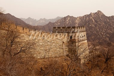 A guardtower stands at the end of an extension of the Great Wall of China at Mutiany in the Beijing province. In the background, the steep mountains provide an indication of the rugged terrain. Stock Photo - Royalty-Free, Artist: searagen                      , Code: 400-05732906