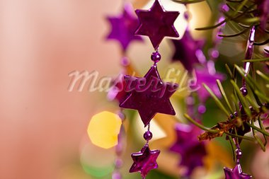 holiday series: christmas lilac stars garland on tree Stock Photo - Royalty-Free, Artist: agg                           , Code: 400-05733623