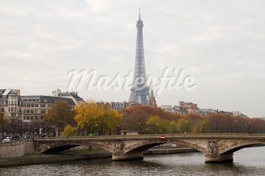 The famous landmark of Paris, Eiffel Tower, as seen over the Invalides bridge (Pont des Invalides) Stock Photo - Royalty-Free, Artist: alexandr6868                  , Code: 400-05734294