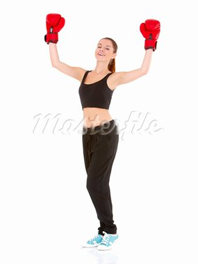 Beautiful sporty woman with boxing gloves on white Stock Photo - Royalty-Free, Artist: dash                          , Code: 400-05734540
