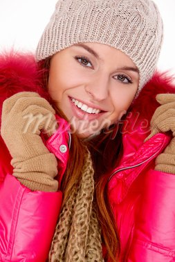 Cute young woman wearing winter jacket scarf and cap Stock Photo - Royalty-Free, Artist: dash                          , Code: 400-05734544