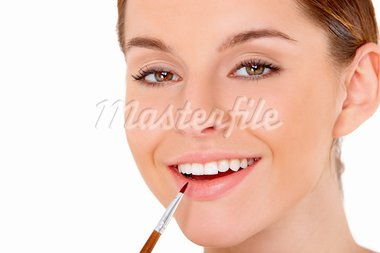 Portrait of beautiful young woman with cosmetics on white Stock Photo - Royalty-Free, Artist: dash                          , Code: 400-05734598