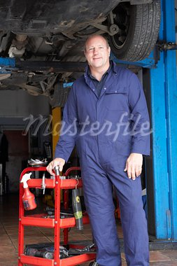 Mechanic working on car Stock Photo - Royalty-Free, Artist: MonkeyBusinessImages          , Code: 400-05735185