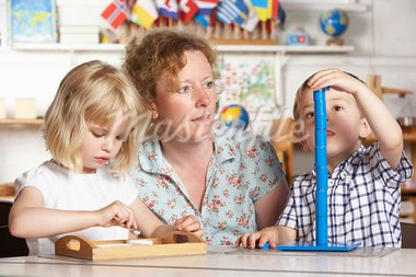 Adult Helping Two Young Children at Montessori/Pre-School Stock Photo - Royalty-Free, Artist: MonkeyBusinessImages          , Code: 400-05735263