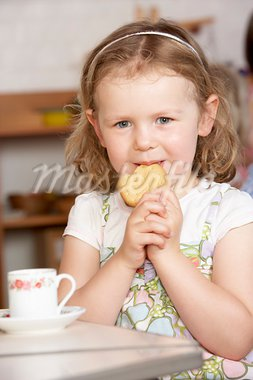 Young Girl Having Tea at Montessori/Pre-School Stock Photo - Royalty-Free, Artist: MonkeyBusinessImages          , Code: 400-05735295
