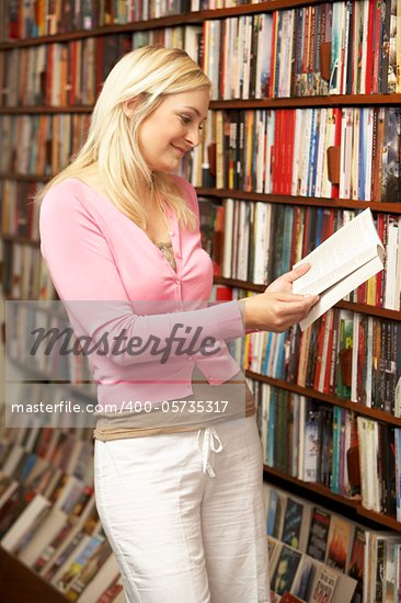 Female customer in bookshop Stock Photo - Royalty-Free, Artist: MonkeyBusinessImages          , Code: 400-05735317