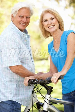 Senior Couple On Cycle Ride In Park Stock Photo - Royalty-Free, Artist: MonkeyBusinessImages          , Code: 400-05736150