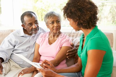 Senior Couple Talking To Financial Advisor At Home Stock Photo - Royalty-Free, Artist: MonkeyBusinessImages          , Code: 400-05736371