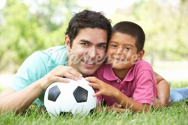 Father And Son In Park With Football Stock Photo - Royalty-Free, Artist: MonkeyBusinessImages          , Code: 400-05736796