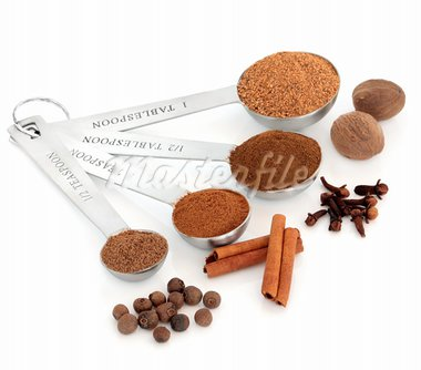 Spice selection of allspice, cinnamon, cloves and nutmeg, ground and whole in measuring spoons isolated over white background. Stock Photo - Royalty-Free, Artist: marilyna                      , Code: 400-05736876
