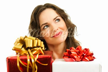 Beautiful young woman choosing christmas presents. Isolated over white. Stock Photo - Royalty-Free, Artist: Jaykayl                       , Code: 400-05737402