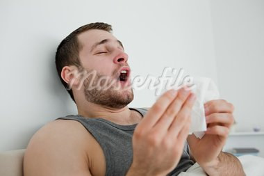 Sick man sneezing in his bedroom Stock Photo - Royalty-Free, Artist: 4774344sean                   , Code: 400-05737430
