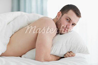 Peaceful young man lying on his belly in his bedroom Stock Photo - Royalty-Free, Artist: 4774344sean                   , Code: 400-05737512
