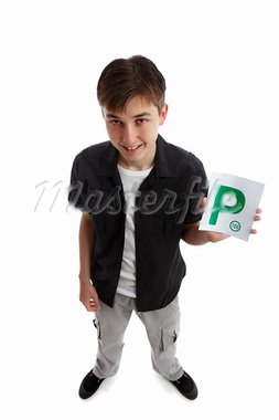 A teenager holds the green magnetic provisional  P plates for vehicle.  White background. Stock Photo - Royalty-Free, Artist: lovleah                       , Code: 400-05738483