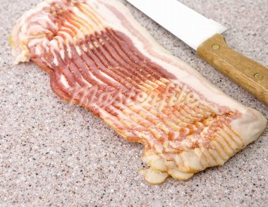 Sliced Raw Bacon And Knife ,Close Up Stock Photo - Royalty-Free, Artist: svetlanna                     , Code: 400-05739012
