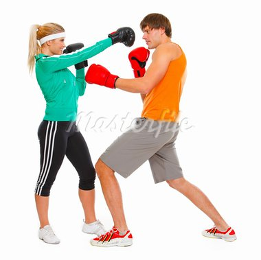 Male and female par in sportswear boxing isolated on white   Stock Photo - Royalty-Free, Artist: citalliance                   , Code: 400-05739385